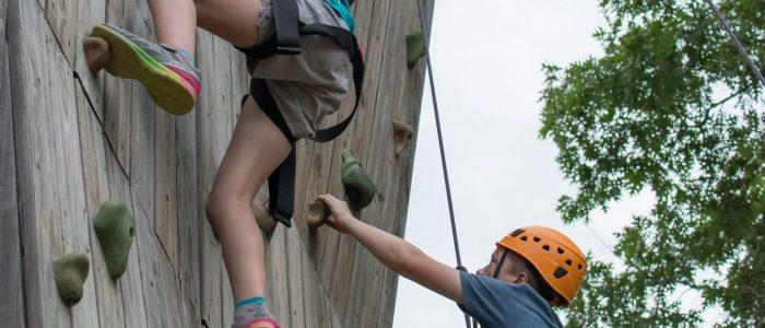 Wildwood adventurers climbing on the rock wall