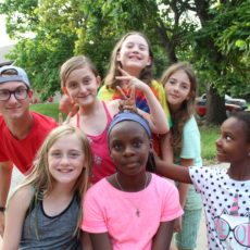 campers goofing around with counselor