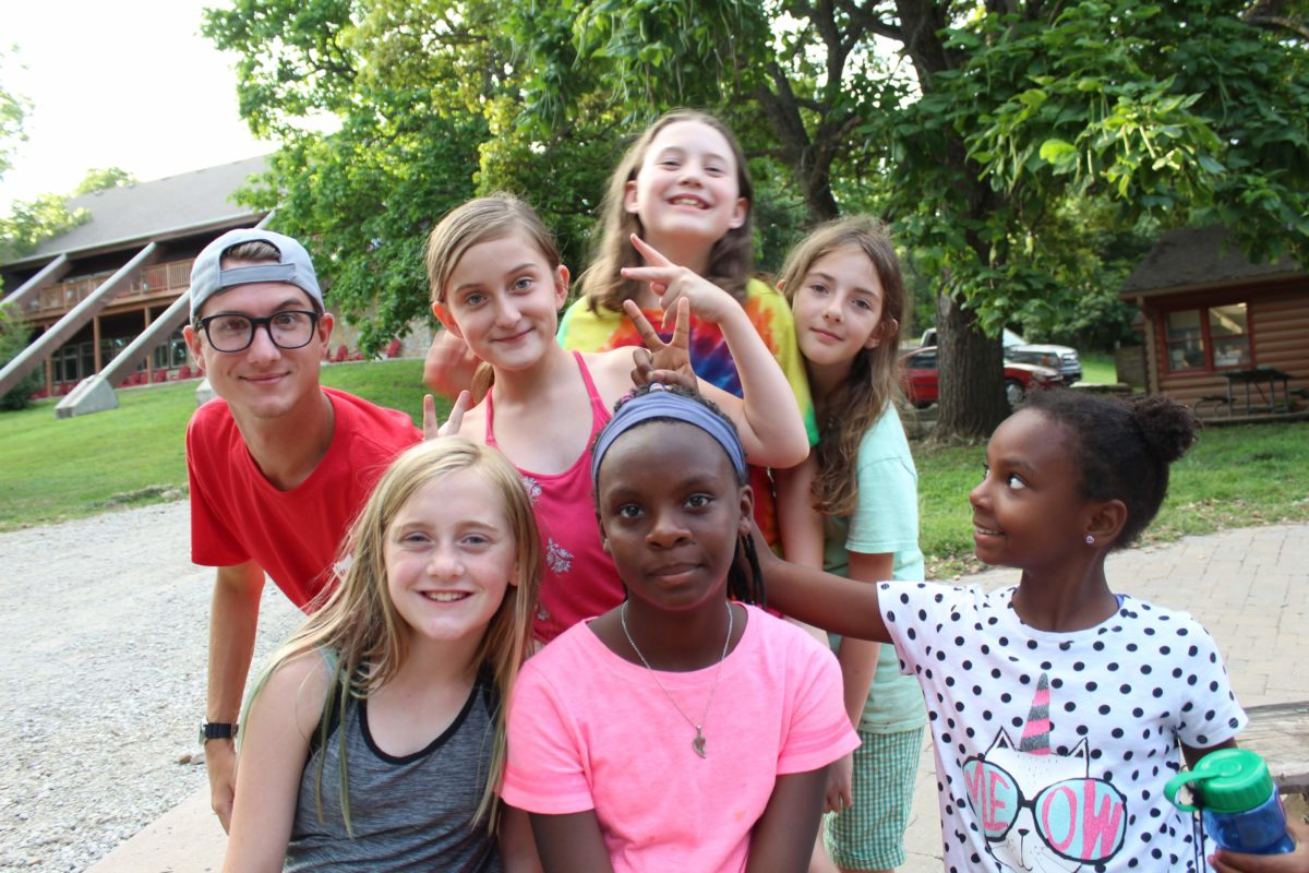 Campers and counselor at campfire
