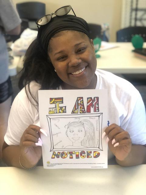 Wildwood camp counselor displaying her Noticed artwork.