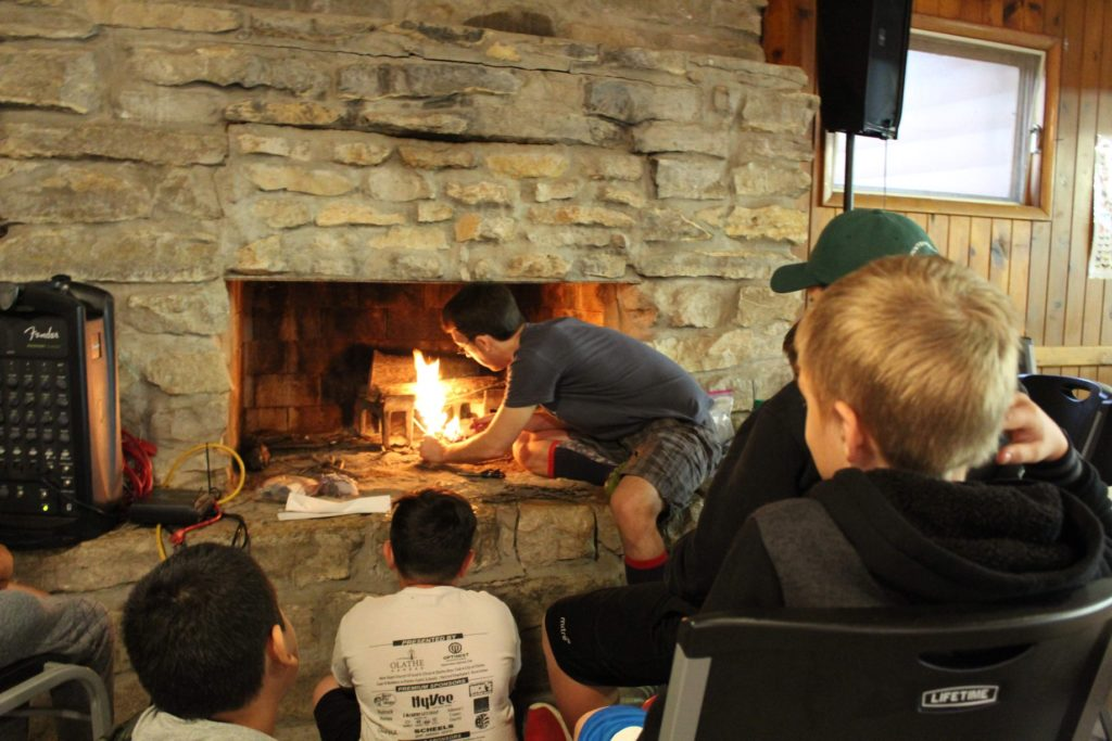 Volunteer counselor, David, built a fire for his cabin