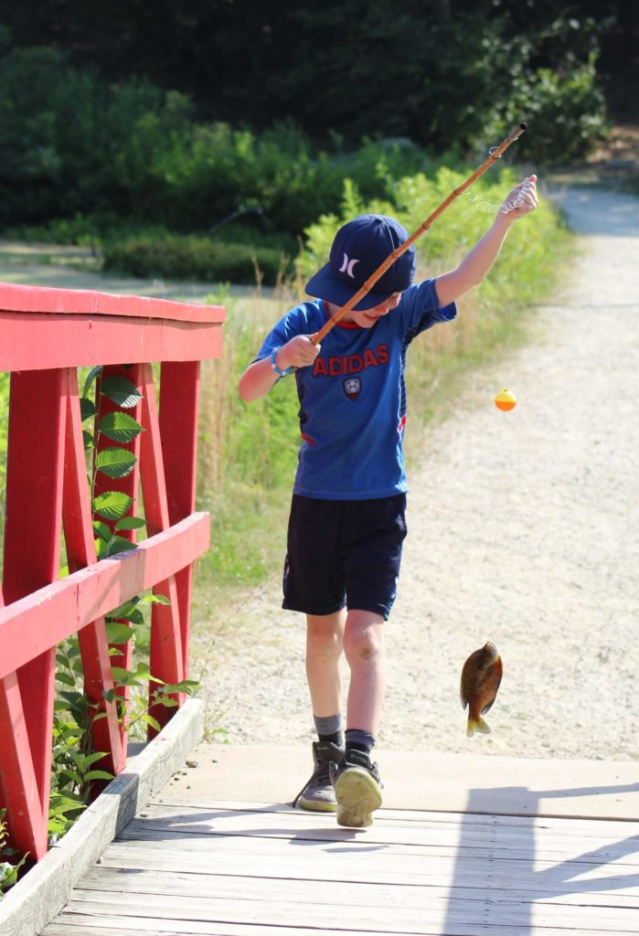 Among other activities, Wildwood campers learn to fish!